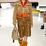 Bella Modeled a Shearling Coat and Orange Waist Bag at Tod's