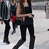 Taylor Tomasi Hill showed off her street-style prowess in all black with a flash of print and jacquard on her vest.