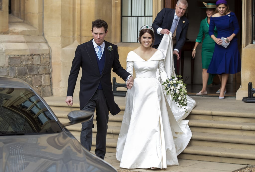 "Princess Eugenie and Jack Brooksbank are married! The couple made things official in front of their family and friends at Windsor's St. George's Chapel on Friday. Following the ceremony, Eugenie and Jack took a romantic carriage ride through the streets of Windsor before attending a special luncheon reception hosted by Queen Elizabeth II. The reception took place in the Waterloo Chamber in Windsor Castle and brought out 800 of the newlyweds' nearest and dearest, including Prince William, Prince Harry, Kate Middleton, and Meghan Markle. Guests were treated to mini bites of beef in Yorkshire pudding and Scotch eggs, and sipped on Pol Roger champagne.  Both Jack and Prince Andrew gave speeches, though Andrew had a little more fun with his as he cracked a few jokes about Jack. ""The Duke told a story about their dog Jack,"" People reports. ""One day, I think it was early in the relationship, he shouted 'Jack, get off the chair!' And the dog didn't move. But Jack did!"" Andrew reportedly ended his speech by giving Jack a big hug. As for Jack's speech, he thanked the guests and ""did what grooms do.""  In the evening, Eugenie and Jack were serenaded by musician Robbie Williams, whose daughter Theodora served as one of the bridesmaids. Guests could grab a bite to eat from the gourmet pizza trucks provided and let loose with Casamigos margaritas, a nod to Jack's work for the tequila brand. Sounds like our kind of party! Eugenie and Jack will continue celebrating their nuptials on Saturday with a festival-themed bash. Congrats to the newlyweds!       Related:                                                                                                           Look Back at Every Photo From Princess Eugenie and Jack Brooksbank's Wedding"