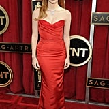 Jessica Chastain looked phenomenal in a red strapless Alexander McQueen number accessorized with a glistening Harry Winston necklace.