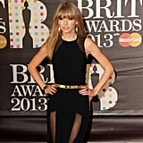 Taylor Swift amped up the sex appeal on the Brit Awards red carpet.