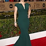 Kate Winslet in a deep green Giorgio Armani gown.