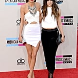 Sisters Kendall and Kylie Jenner stepped onto the American Music Awards red carpet in complementary clothes: they both stuck with a black-and-white colour scheme. While Kendall picked a white strapless top with a white asymmetrical-hemmed mini, Kylie's top and cropped pants were more conservative.