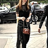 Anne jazzed up her black ensemble with a brown purse.