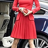 Kate Middleton looked too cute in her rouge outfit.
