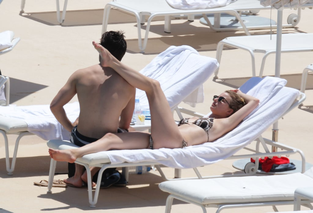 Emily VanCamp and Joshua Bowman lounged poolside in Monaco ...