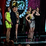 Kristen Stewart, Tayler Lautner, and the rest of the Twilight cast accepted the award for Best Movie.