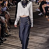 While Tommy Hilfiger gave simple outfits a fun twist with fringed bandanas.
