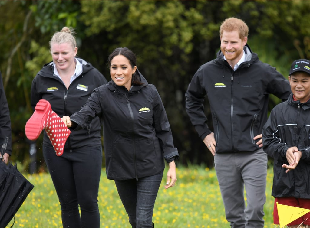 "There's no doubt Meghan Markle and Prince Harry are head over heels for each other, but even their fairy-tale romance needs a little competition every once in a while. During their tour stop in New Zealand, the royal couple split up into separate teams during a game of ""welly wanging,"" and things got adorably heated.  Welly wanging is essentially a competition where participants try to throw a Wellington boot, or rain boot, as far as possible. A video shared by Kensington Palace shows Meghan looking very invested in her toss, while Harry looks on laughing. The duchess did end up taking home the trophy, along with a precious pair of tiny boots for their ""little bump."" Watch Meghan's winning throw ahead, and keep reading to see more snaps from the couple's hilarious outing."