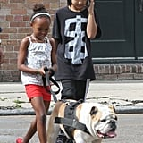 Zahata and Maddox Jolie-Pitt took their beloved Bulldog, Jacques, for exercise in New Orleans in March 2012.
