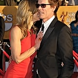 Kyra Sedgwick and Kevin Bacon keep close.