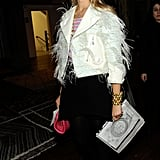 Elisabeth stepped out for Altuzarra's Fall show in a mohair-covered white moto jacket in NYC in February 2012.