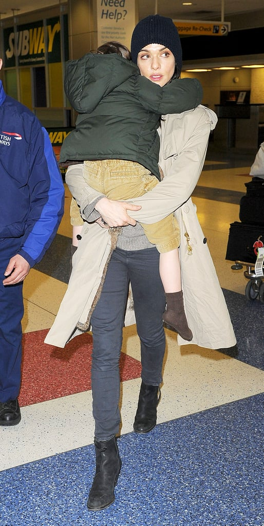 Rachel Weisz arrived at JFK airport yesterday with her son Henry. They were both prepared for the cold weather as Rachel wrapped up warm and wore a cosy hat as they walked through the terminal. Rumours that Rachel could be cast as a Bond villain opposite her boyfriend Daniel Craig have remained unfounded as yet, but she has two projects currently in pre-production. Rachel and Henry's father Darren Aronofsky have remained friends since their split and were spotted out with Henry in New York at the beginning of the year.