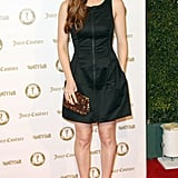 Kate Mara looked chic in a black zippered frock and platform pumps.