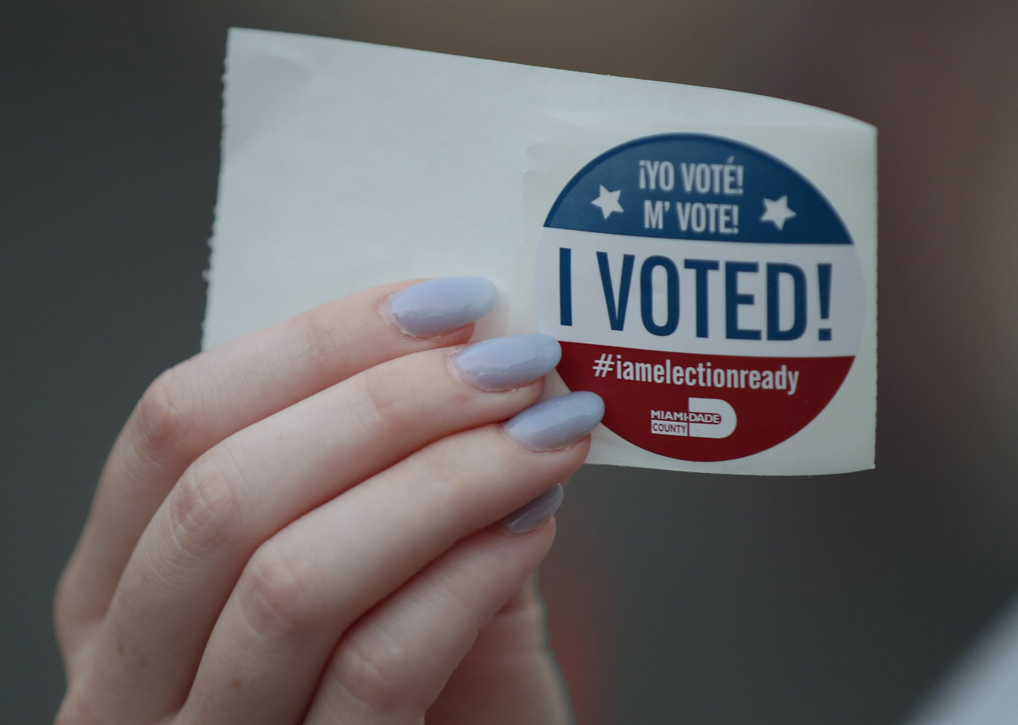 MIAMI, FL  - MARCH 17: A voter shows off her, 'I voted!', sticker after casting a ballot  in her precinct during the Florida presidential primary as the coronavirus pandemic continues on March 17, 2020 in Miami, Florida.  People are heading to the polls to vote for their Republican and Democratic choice in their parties' respective primaries during the COVID-19 outbreak. (Photo by Joe Raedle/Getty Images)