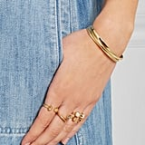 """""""Summer accessorizing is about keeping things simple. What more do you need than a handful of Cornelia Webb's truly unique sculptural rings ($455, set of four)?"""" — HWM"""