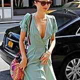 Miranda Kerr stepped onto the side walk in NYC.