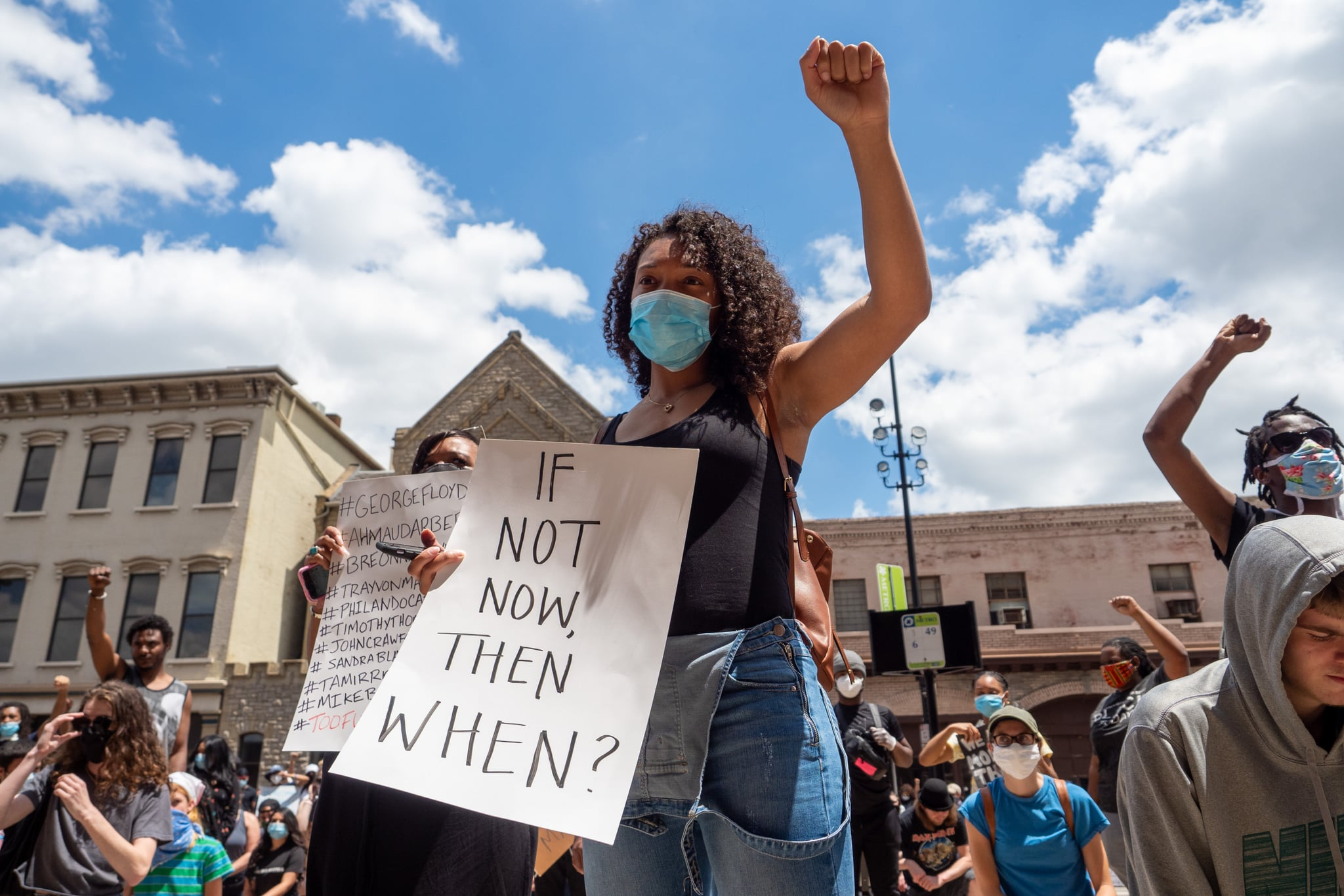 A woman holds up a sign during a Mass Action for Black Liberation protest and march from Washington Park to City Hall following the alleged murder of George Floyd, Saturday, May 30, 2020, in Cincinnati, Ohio, United States. (Photo by Jason Whitman/NurPhoto via Getty Images)