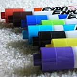 Glue pom-poms to the ends of whiteboard markers to use as erasers.