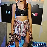 The Vampire Diaries' Kat Graham went for '90s grunge in a leather bralette, denim cutouts, and flannel tied around the waist.