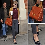 Taylor Swift shows us how to work a tan satchel for chic, street-ready style.