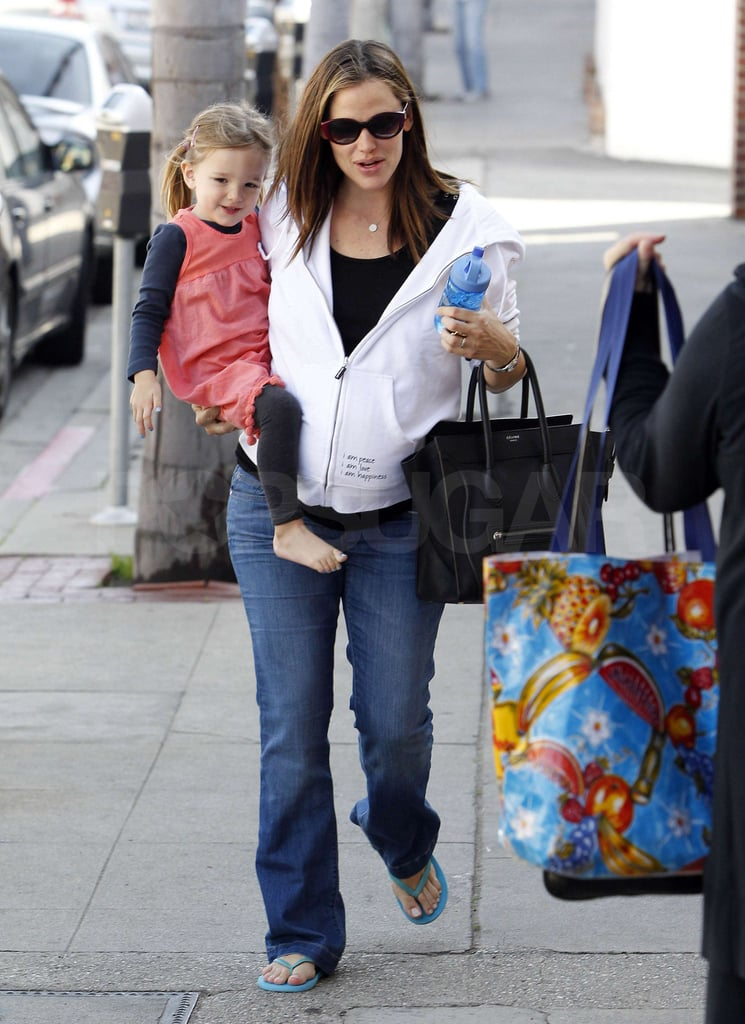 A pregnant Jennifer Garner toted her Celine bag and her youngest daughter, Seraphina, on her hip as she stopped by an LA nail salon today. Jennifer showered her little girl with kisses and the two shared a few secrets as they headed to the spa. The mother and daughter frequently team up to run errands together, but yesterday, Jennifer and Ben Affleck fit in some alone time as they headed out on a walk. Ben is back in town with his girls for the holidays after keeping busy with work on his latest directorial project Argo for much of the year. On Christmas Eve, Jennifer, Ben, Sera, and Violet all did a little last-minute shopping together, and the family is in store for a big gift ahead in 2012, when Jennifer gives birth to her third child. Jennifer recently opened up to InStyle about her family life and her pregnancy, admitting she gives in to cravings like nacho-cheese Doritos when she's expecting!
