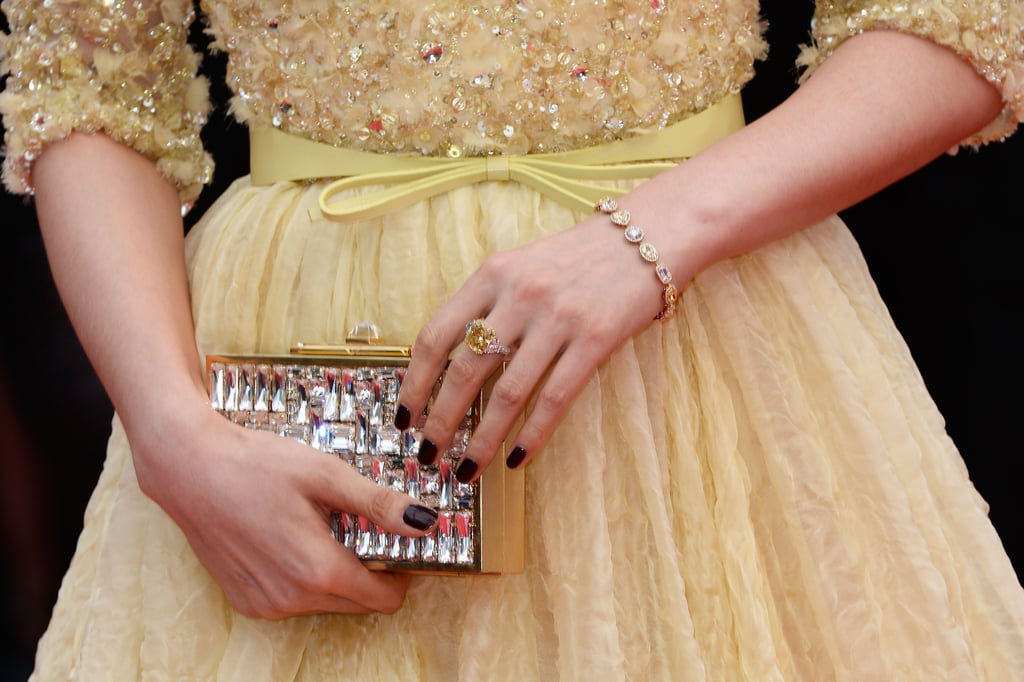 Fan Bingbing carried a crystallised gold clutch and wore yellow diamond jewels by Chopard.