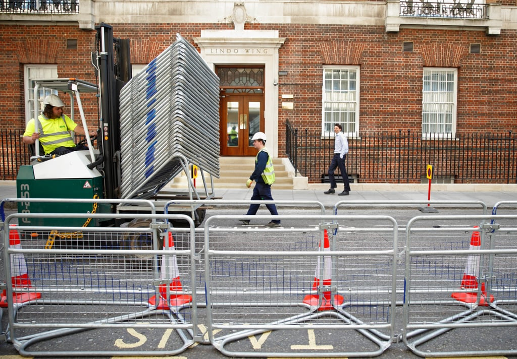 """With just weeks or days left until the Duke and Duchess of Cambridge welcome their second child, preparations are already under way at the hospital where Kate is due to give birth. Just like with Prince George, Kate has chosen the Lindo Wing of St Mary's Hospital in London for the birth. Though there might not be quite as much fanfare as there was with George's arrival, there is still plenty of interest and excitement, and it's evident in the work that's being done outside the hospital. Signs have been up for weeks restricting parking for a """"special event,"""" and barricades are already in place to keep cameras and fans away from the hospital door. While we wait and wonder if the royal couple will welcome a baby boy or a girl and speculate on which name they'll choose, let's take a look at how London is prepping to welcome the fourth in line to the throne."""