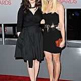 Beth Behrs and Kat Dennings, who wore a tea-length dress.