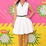 At the 2013 Nickelodeon Kids' Choice Awards, Lucy Hale exuded retro glam in a white Christian Dior shirtdress, which she accessorized via a skinny black belt and black ankle-strap pumps.