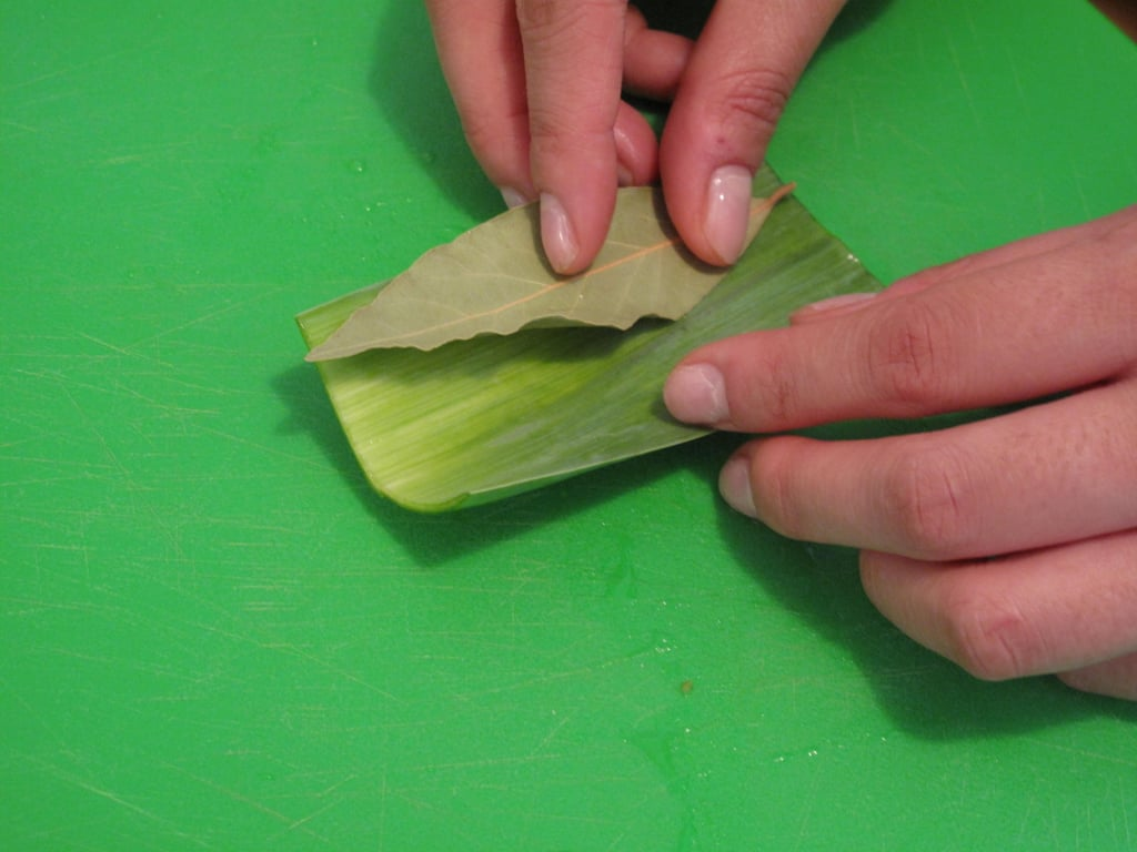 Open the leaf and place the bay leaf inside.
