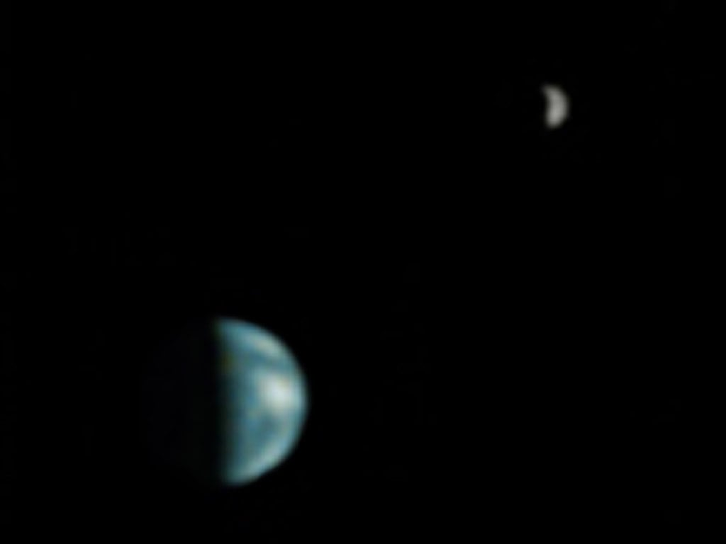 Although not totally clear, this is the first picture of Earth ever taken from another planet that shows it as a planetary disk. Here, we see the Earth and the moon from Mars, captured by the NASA Mars Global Surveyor on May 8, 2003.  Source: NASA/JPL/Malin Space Science Systems