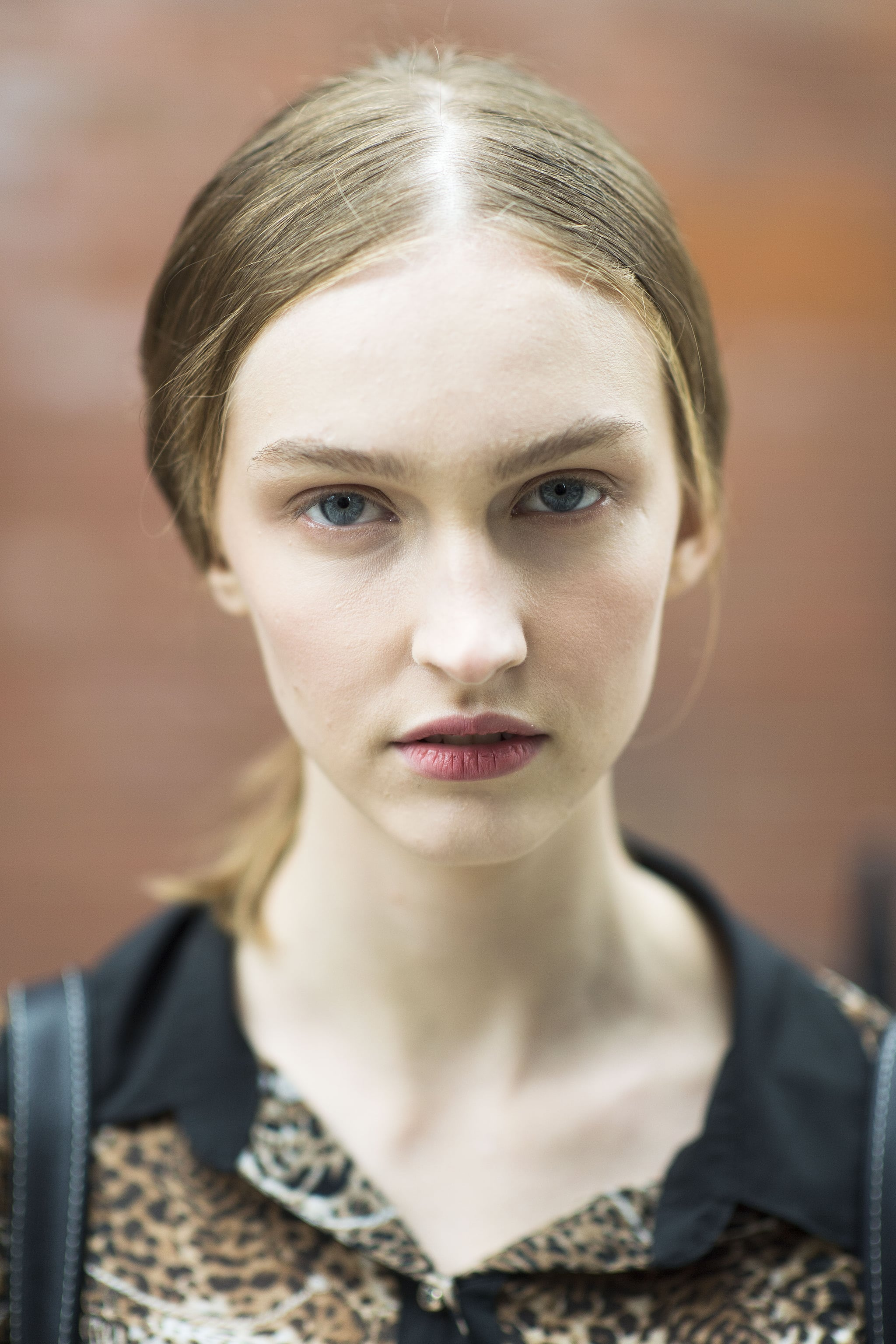 With a middle-parted ponytail and dusty rose lips, this girl looks like she just stepped out of a vintage photograph.  Source: Le 21ème   Adam Katz Sinding