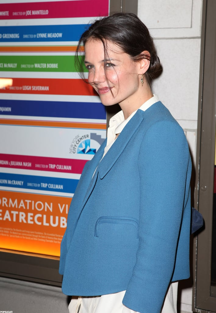 Katie Holmes smiled on her way into the opening night of The Other Side on Broadway.