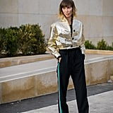 Mix a Glamorous Metallic Piece With Sporty Trousers