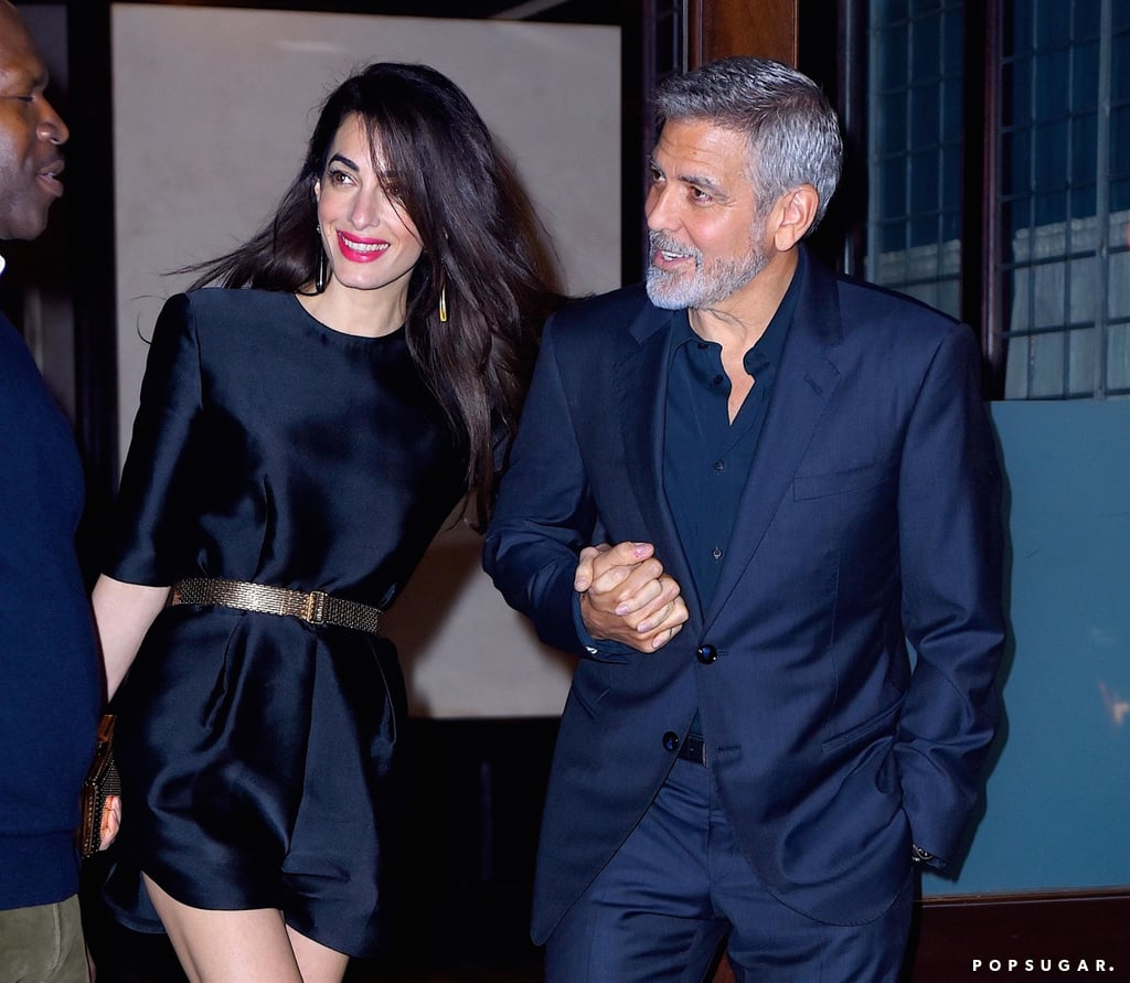 """Amal Clooney may be busy getting ready to host the Met Gala, but you better believe she squeezed in a special date night for George Clooney's 57th birthday. On Sunday, the couple stepped out for dinner at NYC's Laconda Verde restaurant in color-coordinated outfits. Amal and George were as cute as ever as they held hands and flashed big smiles while making their way back to their car.  Amal will be serving as one of the cohosts of this year's Met Gala, along with Rihanna, Donatella Versace, and Vogue's Editor in Chief Anna Wintour. The theme for Monday's event is """"Heavenly Bodies: Fashion and the Catholic Imagination,"""" which focuses on fashion and religion. The last time we saw George and Amal on a red carpet was back in October 2017 at the LA premiere of Suburbicon, so we're definitely looking forward to seeing them together again!      Related:                                                                                                           George Clooney Admits He """"Chased"""" Amal For """"Many Months"""" After They First Met"""