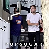Robert Pattinson sported a white t-shirt on the set in Toronto.