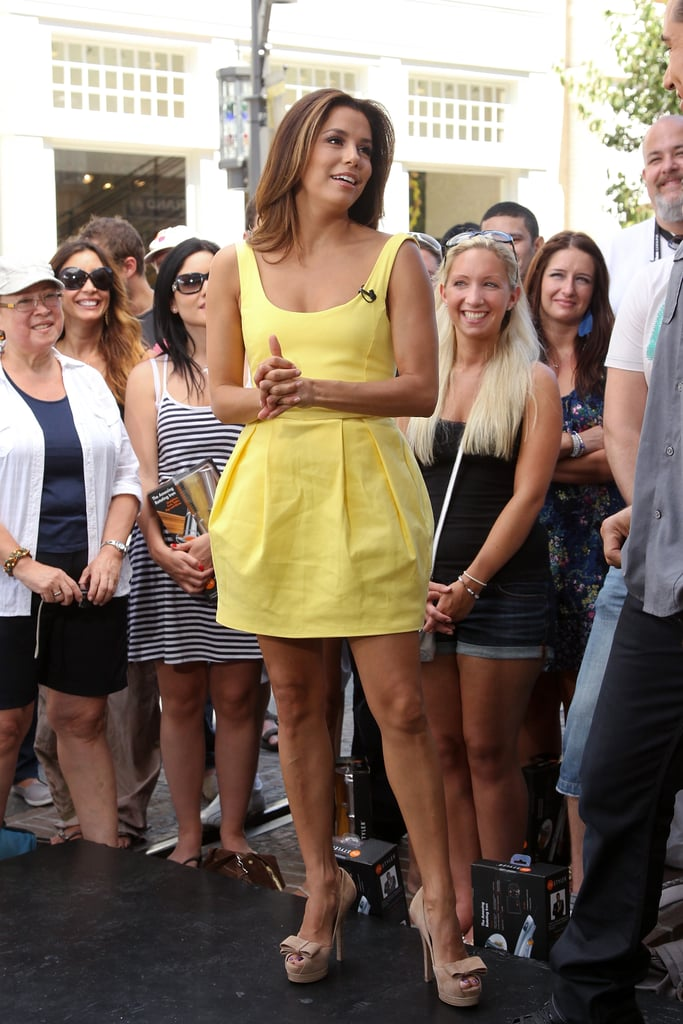 Longoria was the epitome of Summer in a yellow sundress with a tulip skirt. She completed her 2011 Extra look with nude bow pumps and highlighted locks.