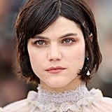 French singer and actress Soko wore a light base with her bob pinned back at the ears at The Dancer photocall.