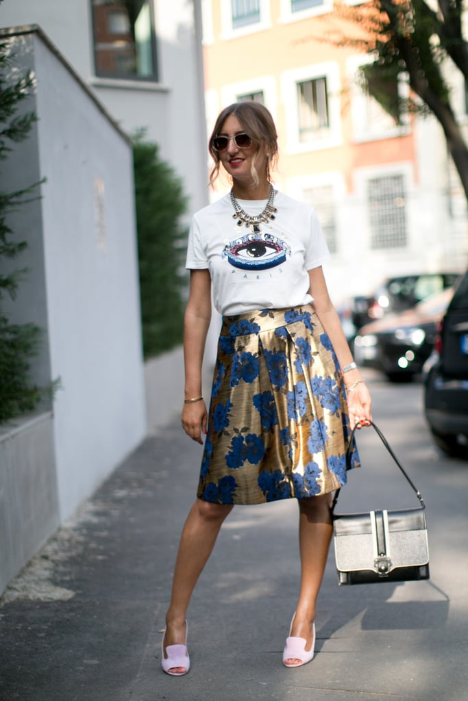 This showgoer made her look count with Kenzo's eye print tee and a ladylike skirt.
