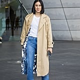 Timeless pieces are always impactful — take this combination of a white t-shirt, trench coat, cropped jeans, and pumps, for example.