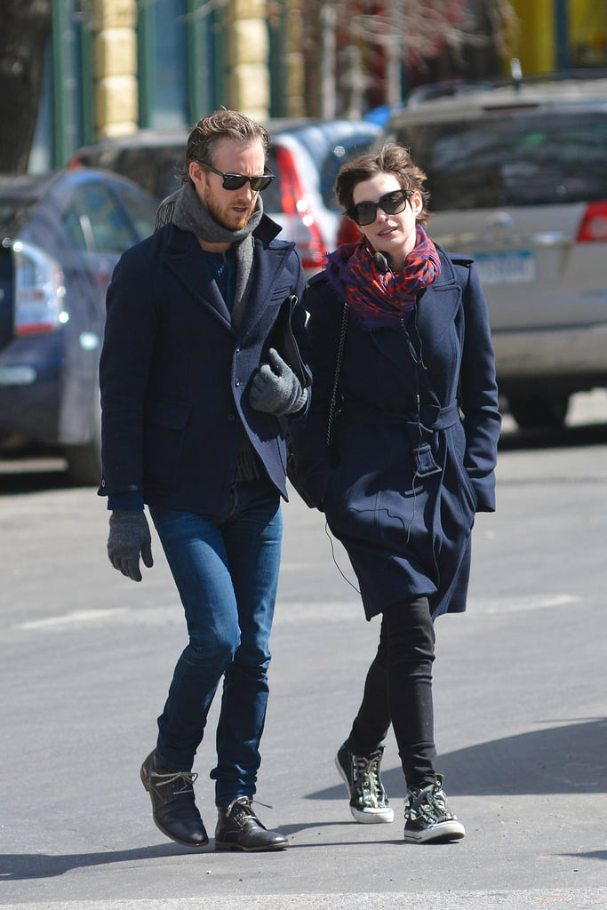Anne Hathaway and Adam Shulman kept close on their outing.