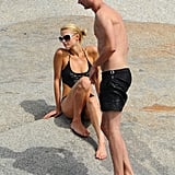 Paris Hilton and her mystery man donned black swimsuits.