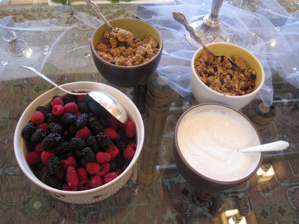 Fresh berries were plated near granola and yogurt.