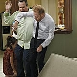 Eric Stonestreet as Cam, Jesse Tyler Ferguson as Mitchell, and Aubrey Anderson-Emmons as Lily on Modern Family.  Photo copyright 2011 ABC, Inc.