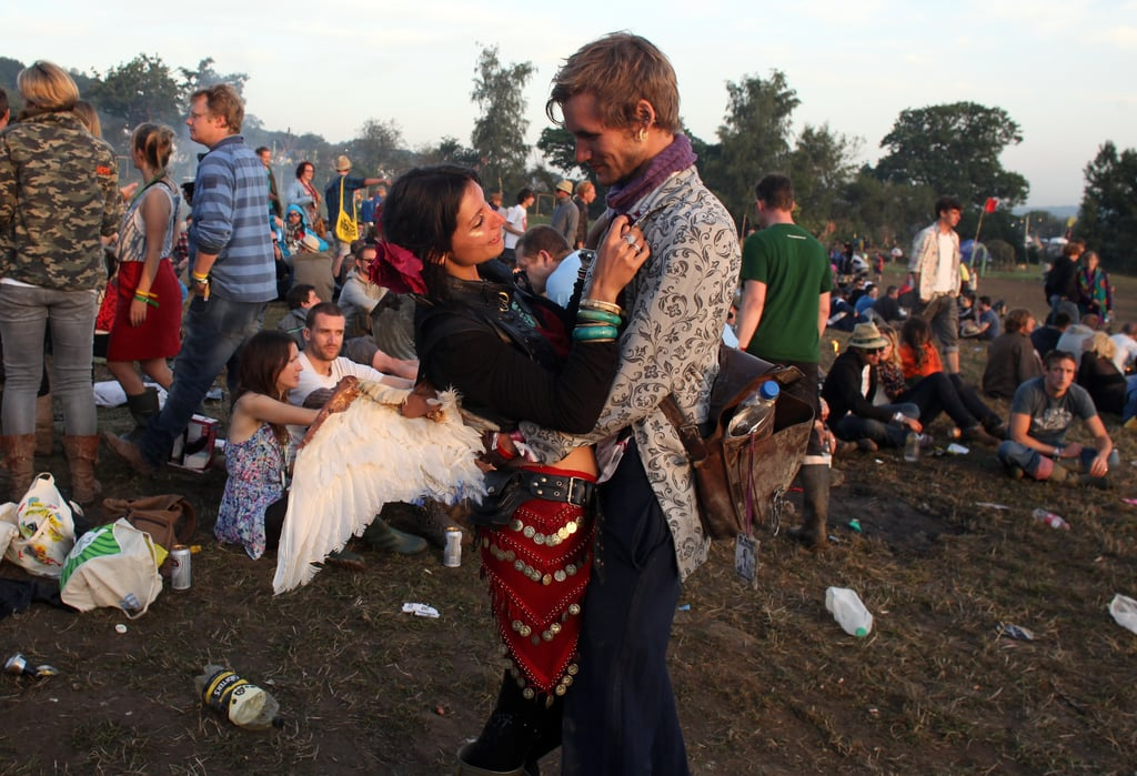 Rise and shine! A couple held each other during sunrise at the Glastonbury festival.