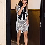 Wearing pajamas out is definitely a theme for Selena. She wore an Olivia von Halle sleep shirt as a dress paired with Puma sneakers.