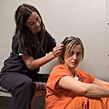 Piper gets a new cellmate who's kind enough to help her out with a hair situation.
