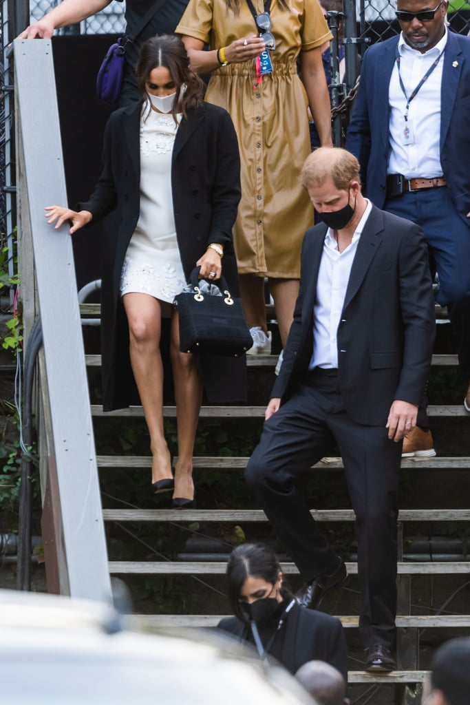 """We all know by now that oftentimes royals — Meghan Markle in particular — dress with intention, and her recent sartorial nod to Princess Diana was no coincidence. As she promoted COVID-19 vaccine equity alongside Prince Harry at Global Citizen Live in New York, the Duchess subtly paid tribute to Diana through one accessory: her Dior bag. The Lady D-Lite purse in Meghan's hand is a modern iteration of the Lady Dior, made famous by Diana in the late '90s. Originally called the Chouchou, the purse was gifted to Diana by the first lady of France at the time, Bernadette Chirac. Upon receiving, Diana carried it on numerous occasions, including at the Met Gala, which prompted the fashion house to rename the iconic purse Lady Dior.  While Meghan's choice honours Diana, her Lady D-Lite has her own touch: """"DSSOS"""" monogrammed across the front in reference to her title. She paired the bag with a white Valentino shift dress featuring floral appliques, a long black coat draped over, as well as sleek black pumps. Ahead, get a side-by-side look at Meghan and Diana carrying their gorgeous Dior purses.       Related:                                                                                                           Princess Diana Has 2 Handbags Named After Her —and They're Still Being Sold Today"""