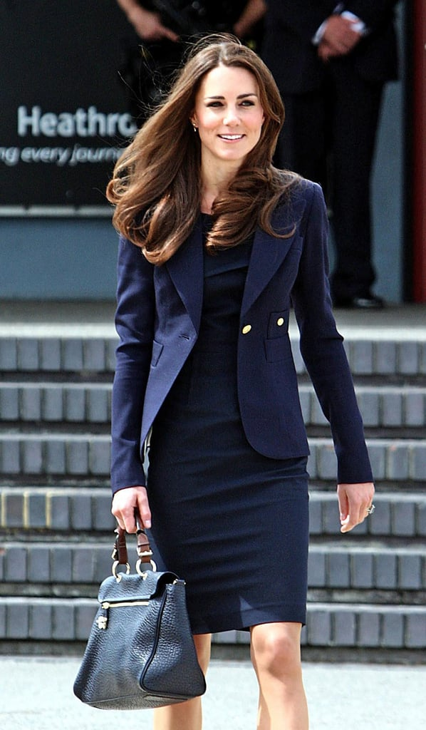 Kate Middleton chose a navy dress and blazer for her trip to Canada.